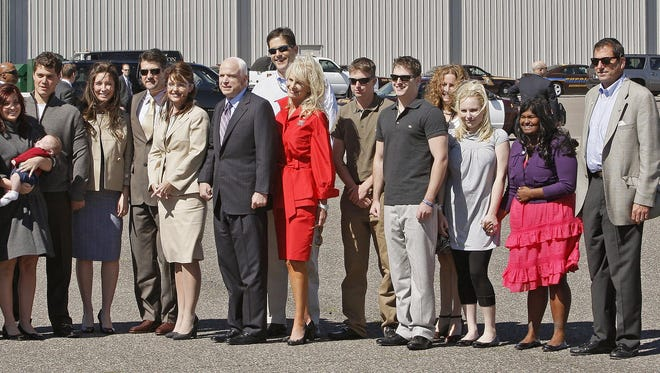 The families of Republican presidential candidate Sen., John McCain, R-Ariz., and his running mate, Alaska Gov. Sarah Palin, pose for a photograph at the airport in Minneapolis, Minnesota, after McCain arrived for the Republican National Convention on Sept. 3, 2008. From left to right: Track Palin, Piper Palin, Willow Palin, holding Trig Palin, Levi Johnson, Bristol Palin, Todd Palin, Gov. Palin, Sen. McCain, Andy McCain, Cindy McCain, Jimmy McCain, Jack McCain, Sidney McCain, Meghan McCain, Bridgette McCain, Doug McCain.