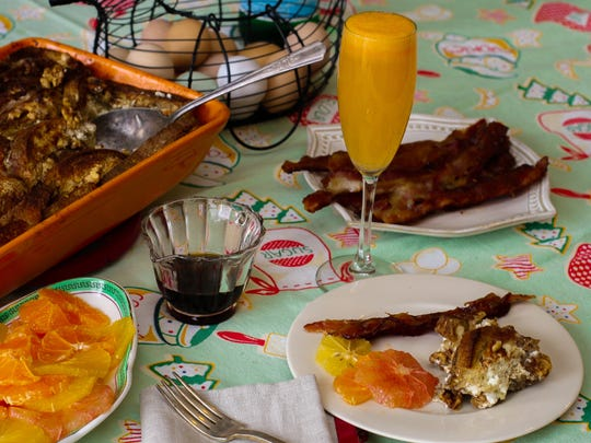 New Year's Day brunch features citrus slices, fresh citrus spritzers, and make-ahead baked bacon and baked French toast.