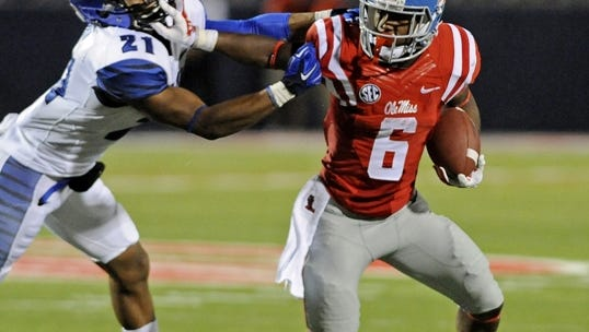 Mississippi running back Jaylen Walton (6) stiff-arms Memphis defensive back Bobby McCain (21) during the second half of an NCAA college football game in Oxford, Miss., Saturday, Sept. 27, 2014. No. 10 Mississippi won 24-3. (AP Photo/The Daily Mississippian, Thomas Graning)