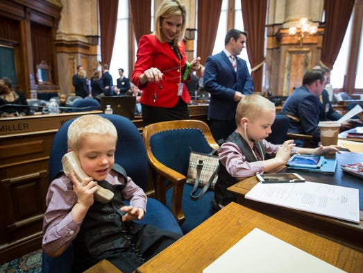 Jackson and Max Hinson, occupy their mother's desk,