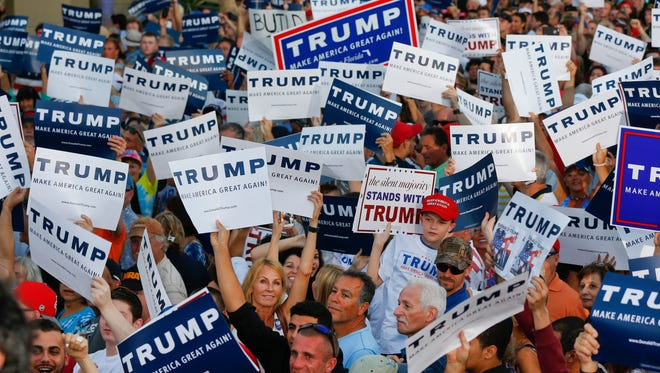Supporters cheered Republican presidential candidate Donald Trump during a campaign rally Sunday, March 13, 2016, in Boca Raton, Fla.