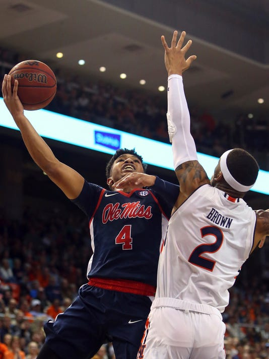 Mississippi guard Breein Tyree (4) puts up a shot over Auburn guard Bryce Brown (2) during the first half of an NCAA college basketball game, Tuesday, Jan. 9, 2018, in Auburn, Ala. (AP Photo/Butch Dill)