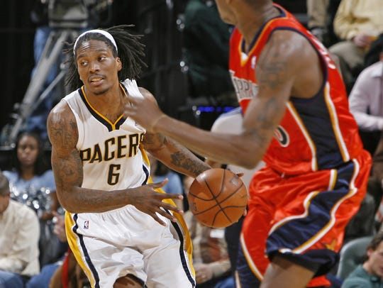 Marquis Daniels brings the ball up court against the