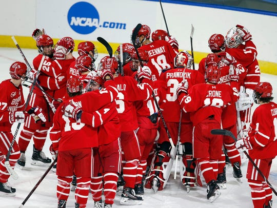 Boston players celebrate their 3-1 win over Cornell