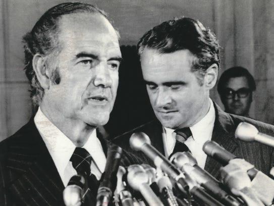 Sen. Thomas Eagleton (right) listens as Sen. George