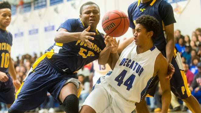 Stephen Decatur center Kevem Aluma (44) fights for a rebound with Pocomoke forward LiCurtis Whitney (50) at Stephen Decatur High School on Tuesday, Jan 26.