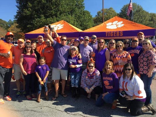 """Suzanne Shumway and her fellow Clemson """"tiger tailgaters."""""""
