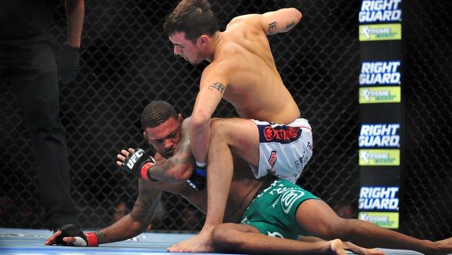 Myles Jury strikes Michael Johnson during UFC 155 at the MGM Grand Garden Arena.