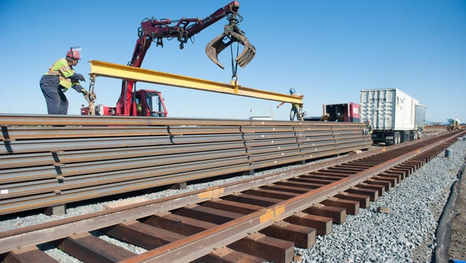 Workers with the Railroad Construction Company in Paulsboro work on laying 3.5 miles of new track at the Port of Paulsboro. Thursday, October 15, 2015.