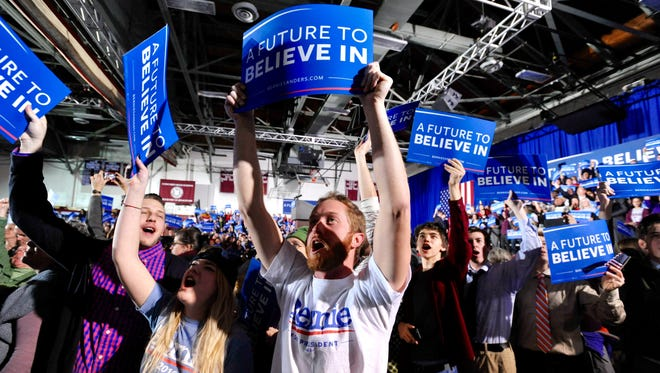 Supporters of Democratic presidential candidate Sen. Bernie Sanders, I-Vt., cheer as Secretary of State Hillary Clinton concedes the race on primary election night in Concord, N.H., on Tuesday, Feb. 9, 2016.