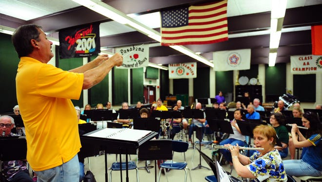 Gerald Guilbeaux conducts the Lafayette Concert Band during a 2013 rehearsal at Acadiana High School.