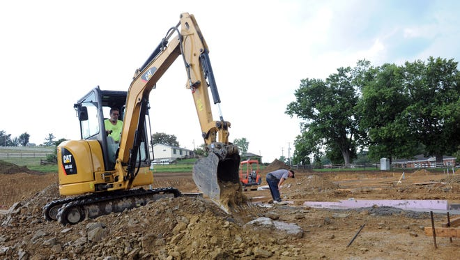 Construction workers lay the foundation for the new Dollar General store located just west of Jersey Ridge Road on West Pike in Zanesville. The location is scheduled to open in fall 2016.
