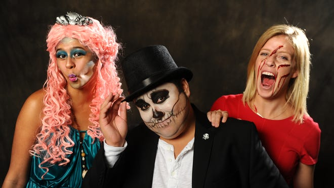 From left, Pacific Daily News reporters Chloe Babauta made up as a mermaid, Shawn Raymundo, a dandy skeleton, and Katy Clarke, slasher victim.