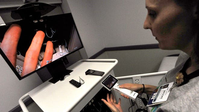 Brooke Nobles, a registered nurse at Cook Children's Pediatric Specialty Clinic in Abilene, demonstrates the portable camera on their telemedicine unit Thursday June 29, 2017 during at an open house. The device allows a doctor in Fort Worth to examine a patient remotely with the assistance of onsite nurse.