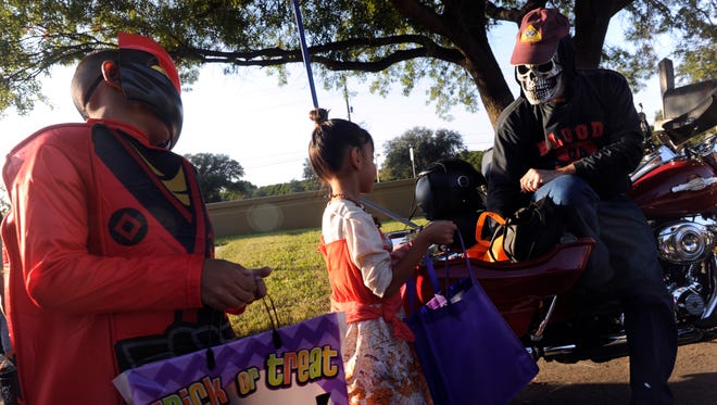 """""""Ghost Rider"""" Bert Simpson of the Patriot Guard, passes out candy at the Elliott-Hamil Funeral Home on U.S. 277 Tuesday evening Oct. 31, 2017. This was the first year the funeral home has held a trunk or treat."""