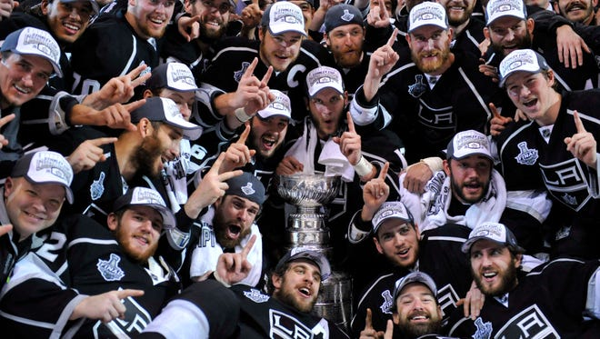 Los Angeles Kings players pose for a team photo after winning the Stanley Cup for the second time in three seasons.
