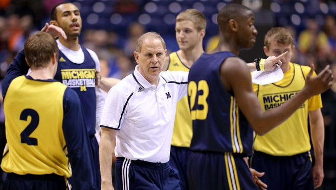 Michigan head coach John Beilein talks to his players.. The four team in the NCAA Division 1 Men's Basketball Championship Midwest Regional round practiced Thursday afternoon at Lucas Oil Stadium.