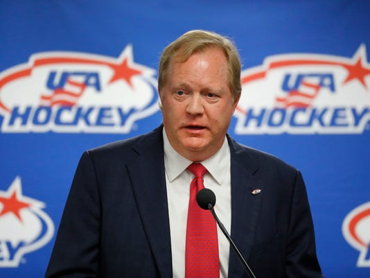 FILE - This Aug. 4, 2017 file photo shows Jim Johannson speaking during a news conference in Plymouth, Mich. Johannson, the general manager of the U.S. Olympic men's hockey team, has died just a couple weeks before the start of the Pyeongchang Games, Sunday, Jan. 21, 2018. He was 53. (AP Photo/Paul Sancya)