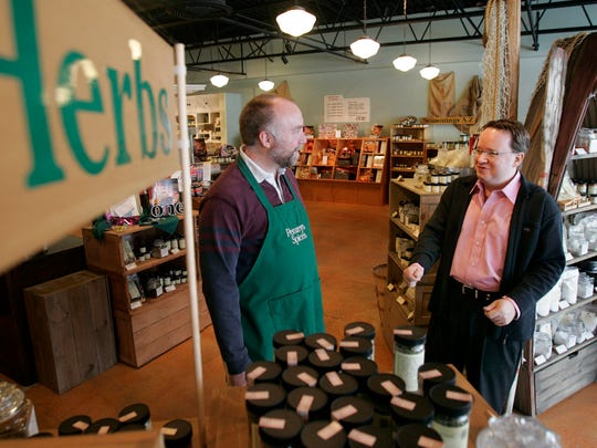 Bill Penzey (right), founder of Penzeys Spices, talks to quality control manager Scott Nelson (left) in the retail shop in Brookfield in 2007.