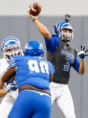 Memphis quarterback Brady White makes a pass during the teams spring football game at Liberty Bowl Memorial Stadium.