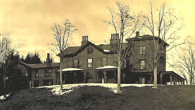 This early 20th-century image of the Springwood mansion's west elevation shows the additions James Roosevelt made in 1887.