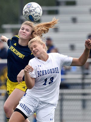 Webster Schroeder's Muira Fontaine, right, and Spencerport's Leah Wengender challenge for a header during a regular season game at Webster Schroeder High School on Saturday, Sept. 17, 2016. Webster Schroeder and Spencerport played to a 1-1 draw.