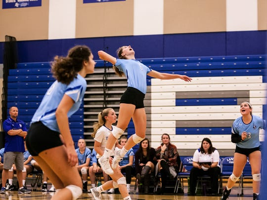 Cami Herman rises for an attack for the Brookfield Central volleyball team. Herman has been working toward acceptance into the U.S. Naval Academy after high school.