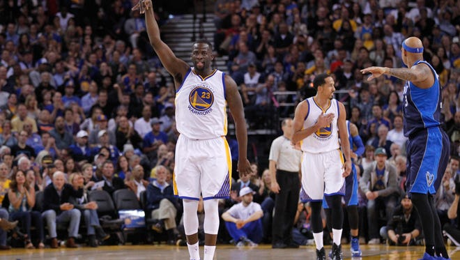 Golden State Warriors forward Draymond Green (23) reacts after making a three point basket against the Dallas Mavericks in the second quarter at Oracle Arena.