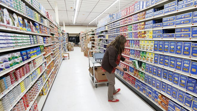 Lisa Ingariola, Retail Technology Coordinator for Associated Supermarket Group works on entering products into the point of sale systyem at Met Fresh Supermarket in Central Nyack on Tuesday, June 21, 2016.