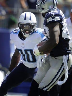 Titans cornerback Jason McCourty stops Cowboys wide receiver Dez Bryant during the second quarter last Sunday at LP Field.