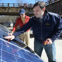 FLS Energy engineers Russ Thacher, left, and K.C. Radford test some of the photovoltaic panels at the plant in Asheville. FLS Energy is one of six Asheville companies on the Inc. 5000 list for 2015.