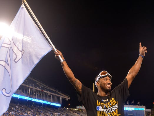 Game 3 in Kansas City - Royals 8, Angels 3: Alcides Escobar celebrates with the fans after advancing to the ALCS.