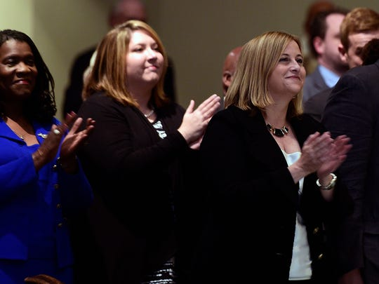 Mayor-elect Megan Barry,right, claps to the music of