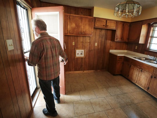 Steve Lockwood, Executive Director of the Frayser Community Development Corporation conducts a tour of a three bedroom house the Frayser CDC is selling near Lucie Campbell Elementary School. The home features new tile floors, a carport and new roof for the affordable price of $62,000.