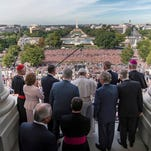 Pope Francis, center, joins House and Senate leaders and clergy Thursday on the balcony of the speaker of the House at the U.S. Capitol in Washington after the pope spoke to a joint session of Congress.