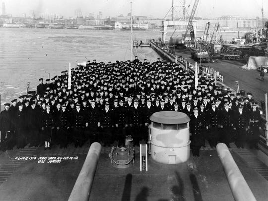 The crew of the U.S.S. Juneau pose for a photo on deck