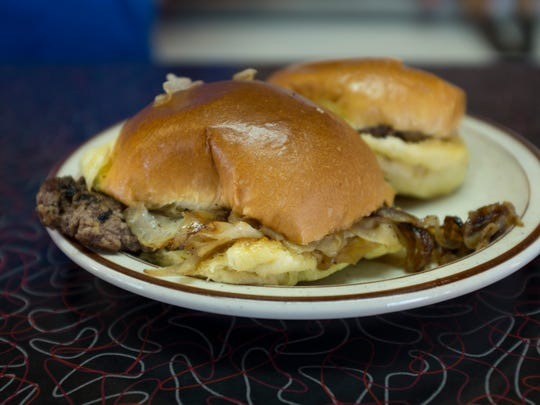 A plate of classic sliders sits on a counter during a fundraising event Saturday, October 10, 2015 at Power's Diner in Port Huron. 25 cents from each slider purchase Saturday will benefit the Port Huron Old Newsboys.