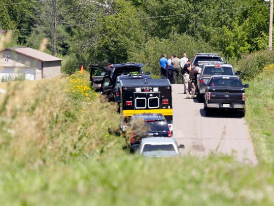 Police officials investigate at the end of Hillview Road in Merrill where an officer involved shooting took place July 26, 2016.