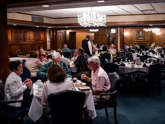 Members are served dinner at the Petroleum Club in