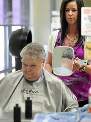 Brenda Wade Schmidt has her hair shaved off by Stacey Kranz at Great Clips.