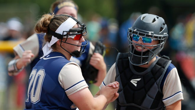 Susquehanna Valley's pitcher, Sophia Pappas gets a congratulations from catcher, Emily DeMoney during Saturday's class Class B semi-final game at the NYSPHSAA Softball Championships in Ganesvoort on June 9, 2018. Pappas had her 1000th strike out during the game.
