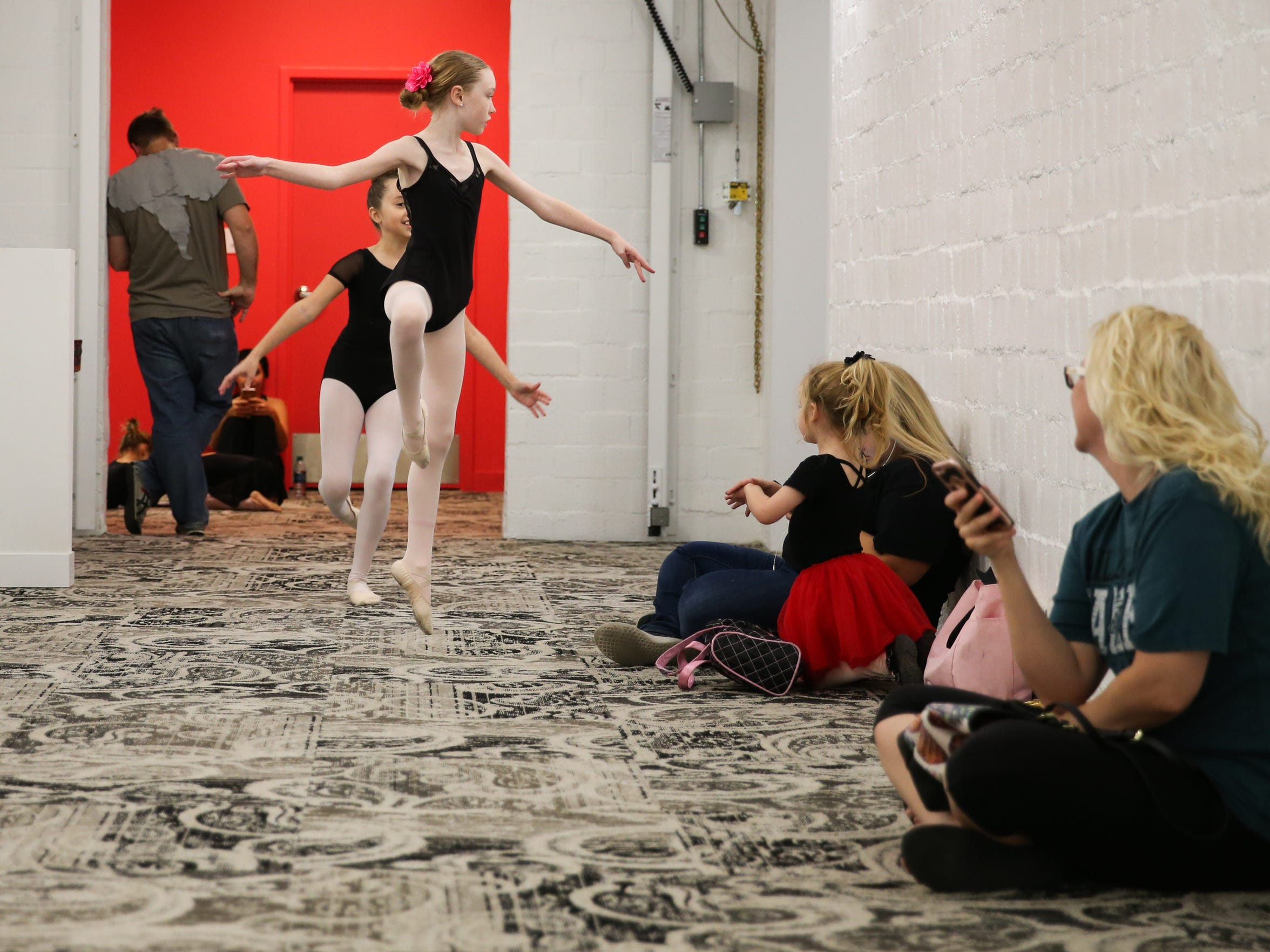 Ballet San Angelo students dance down a hallway at