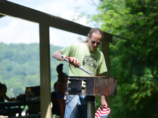 Alan Larsen of Binghamton grills during the July Fourth