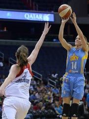 Chicago Sky guard Allie Quigley (14) hits a jump shot over Washington Mystics center Emma Meesseman (33) in the fourth quarter at the Verizon Center in Washington, Friday, June 13, 2014. Tee Mystics defeated the Sky, 79-68. (Photo by Chuck Myers/MCT/Sipa USA)