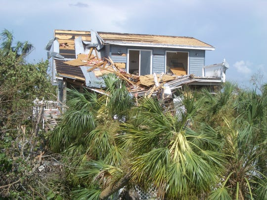 Photo of North Captiva after Charley taken by Kristie Anders of Sanibel Captiva Conservation Foundation. She lived on Captiva and rode out Charley in the fire station. This is a neighbor's house.