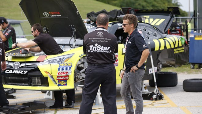 NASCAR Xfinity driver Cale Conley talks with crew chief Eddie Pardue prior to practice at Road America Friday.