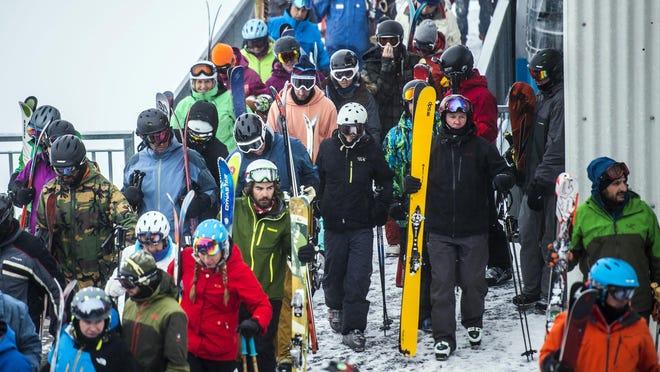 This photo taken Dec. 30, 2016, shows skiers and snowboarders offloading at the tram at Hidden Peak at Snowbird Ski and Summer Resort in Snowbird, Utah.