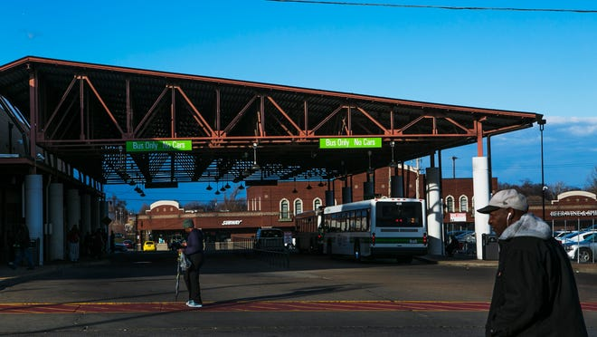 Bus riders walk outside the downtown Memphis Area Transit Authority after exiting a bus on Feb. 16, 2016.