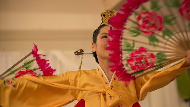Dr. Heejay Chung of San Francisco performs a traditional Korean dance during the Asian Art Society of Monterey Bay annual gala at Rancho Canada Golf Club on Jan. 31 in Carmel-By-The-Sea.