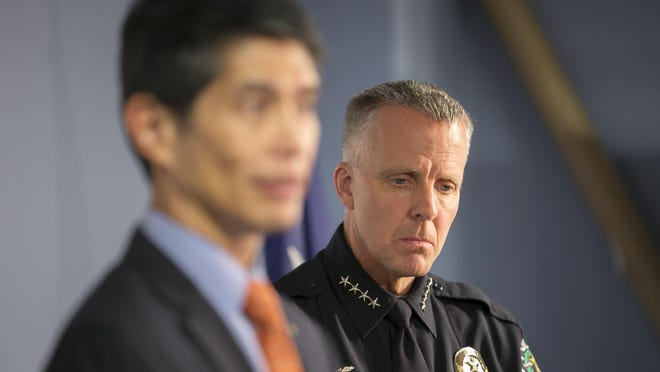 Austin Police Chief Brian Manley, right, listens as Assistant City Manager Rey Arellano answers questions on Dec. 16, 2016, after it was announced that the Austin Police Department would cease efforts to reopen its DNA lab.